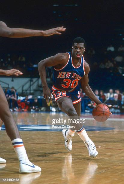 Bernard King of the New York Knicks dribbles against the Washington Bullets during an NBA basketball game circa 1984 at the Capital Centre in...