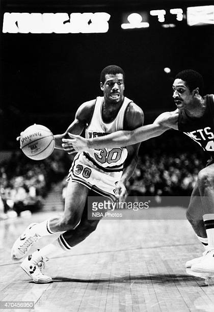 Bernard King of the New York Knicks drives against the New Jersey Nets circa 1985 at the Madison Square Garden in New York City New York NOTE TO USER...