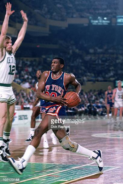 Bernard King of the New York Knicks drives to the basket against the Boston Celtics during a game played in 1987 at the Boston Garden in Boston...