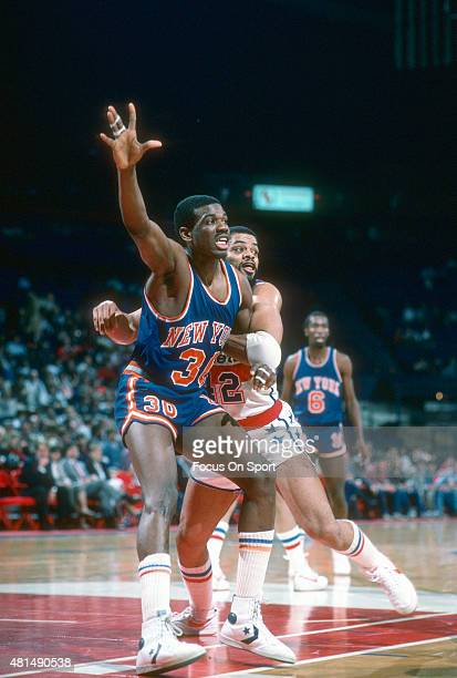 Bernard King of the New York Knicks fights for position with Greg Ballard of the Washington Bullets during an NBA basketball game circa 1985 at the...