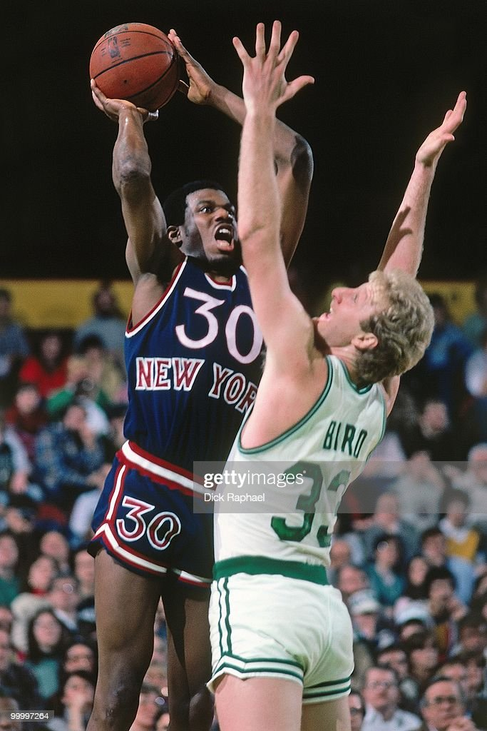 Bernard King #30 of the New York Knicks goes up for a shot against Larry Bird #33 of the Boston Celtics during a game played in 1983 at the Boston Garden in Boston, Massachusetts.
