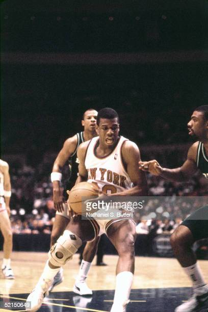 Bernard King of the New York Knicks looks to make a move in the paint against the Milwaukee Bucks during an NBA game in 1986 at Madison Square Garden...