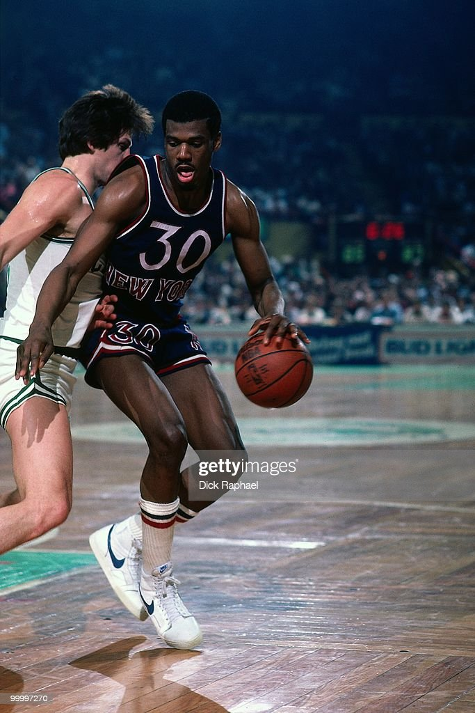 Bernard King #30 of the New York Knicks makes a move to the basket against the Boston Celtics during a game played in 1983 at the Boston Garden in Boston, Massachusetts.