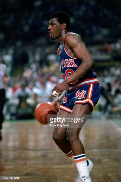 Bernard King of the New York Knicks moves the ball up court against the Boston Celtics during a game played in 1984 at the Boston Garden in Boston...
