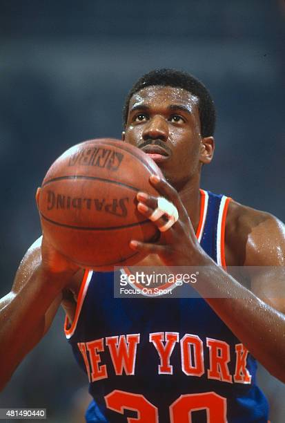 Bernard King of the New York Knicks shoots a free throw against the Detroit Pistons during an NBA basketball game circa 1982 at the Pontiac...