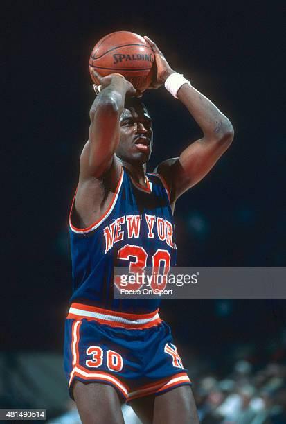 Bernard King of the New York Knicks shoots a free throw against the Washington Bullets during an NBA basketball game circa 1985 at the Capital Centre...