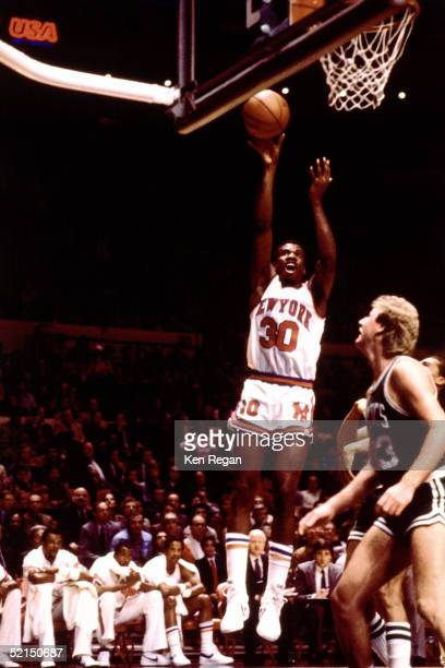 Bernard King of the New York Knicks shoots a jump shot against the Boston Celtics during an NBA game in 1984 at Madison Square Garden in New York New...