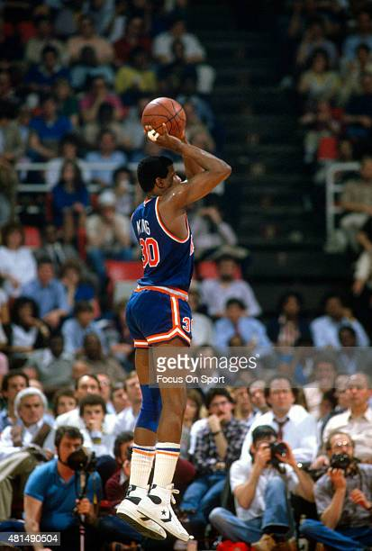 Bernard King of the New York Knicks shoots against the Detroit Pistons during an NBA basketball game circa 1982 at the Pontiac Silverdome in Pontiac...