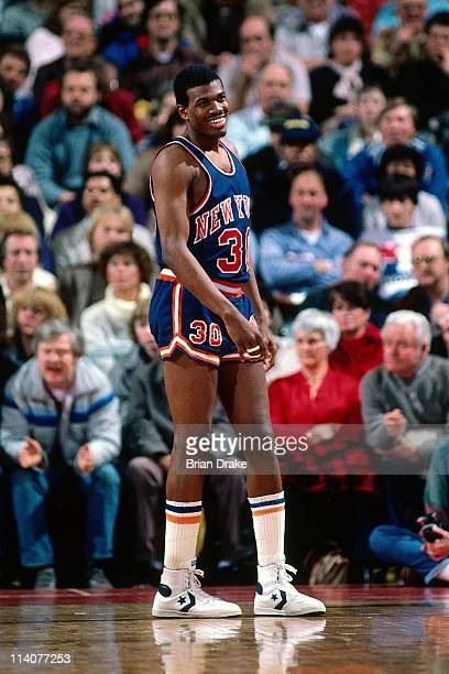 Bernard King of the New York Knicks smiles against the Portland Trailbalzers at the Veterans Memorial Coliseum in Portland Oregon circa 1984 NOTE TO...