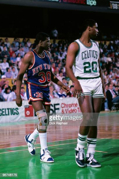Bernard King of the New York Knicks stands next to Darren Daye of the Boston Celtics during a game played in 1987 at the Boston Garden in Boston...