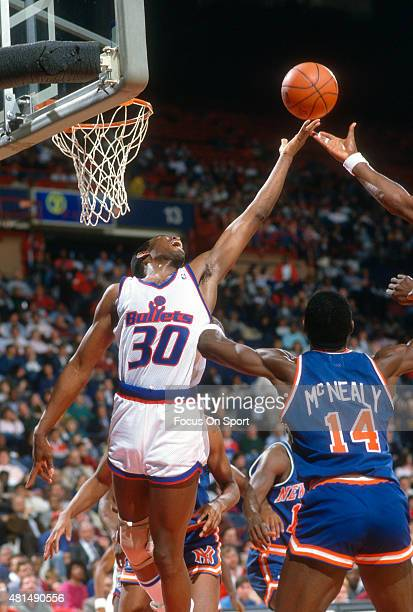 Bernard King of the Washington Bullets battles for rebound against the New York Knicks during an NBA basketball game circa 1989 at the Capital Centre...