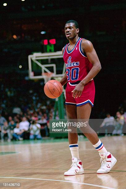 Bernard King of the Washington Bullets dribbles against the Milwaukee Bucks circa 1988 at the Bradley Center in Milwaukee Wisconsin NOTE TO USER User...