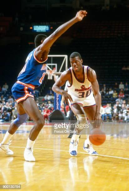 Bernard King of the Washington Bullets dribbles the ball against the New York Knicks during an NBA basketball game circa 1989 at the Capital Centre...