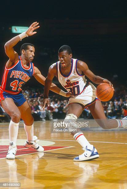 Bernard King of the Washington Bullets drives on Adrian Dantley of the Detroit Pistons during an NBA basketball game circa 1987 at the Capital Centre...