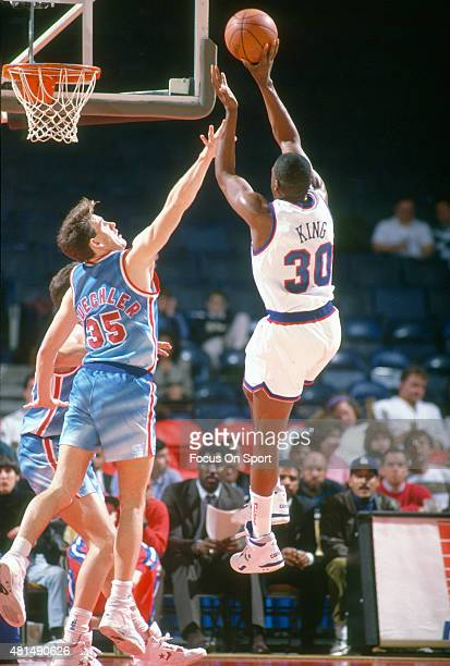 Bernard King of the Washington Bullets shoots over Jud Buechler of the New Jersey Nets during an NBA basketball game circa 1991 at the Capital Centre...