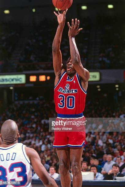 Bernard King of the Washington Bullets shoots the ball against the Sacramento Kings during a game played on December 6 1990 at Arco Arena in...