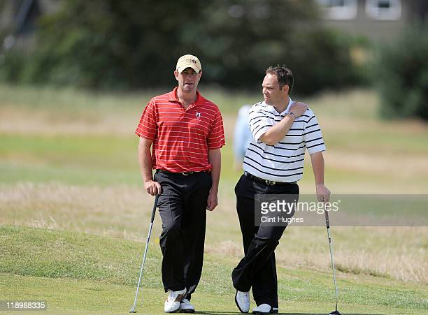 Bernard Kitching and Gary Watson of Keswick Golf Club have a discussion on the eighth hole during the Virgin Atlantic PGA National ProAm Championship...