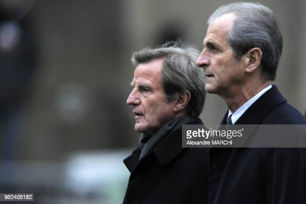 Bernard Kouchner and Hubert Falco arrive for the funeral of French politician Philippe Seguin at the SaintLouisdesInvalides Church in Paris