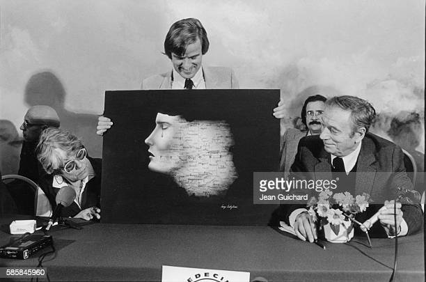 Bernard Kouchner at Press Club surrounded by actors Simone Signoret and Yves Montand
