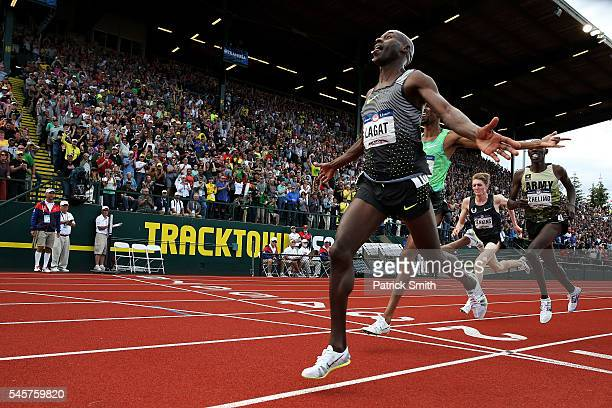 Bernard Lagat, first place, crosses the finishline in the Men's 5000 Meter Final during the 2016 U.S. Olympic Track & Field Team Trials at Hayward...