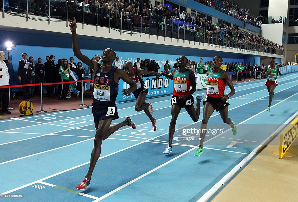 Bernard Lagat of the United States celebrates as crosses the line to win gold ahead of Mo Farah of Great Britain Edwin Sol of Kenya and Augustine Choge of Kenya in the Men's 3000 Metres Final during day three of the 14th IAAF World Indoor Championships at the Atakoy Athletics Arena on March 11, 2012 in Istanbul, Turkey