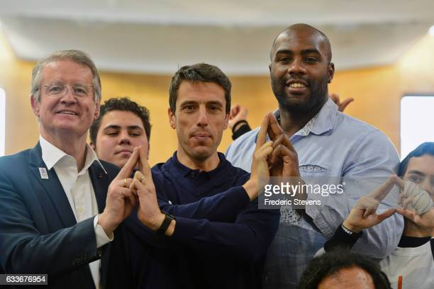 Bernard Lapasset president of Paris 2024 IOC member Tony Estanguet and Teddy Riner pose during the visit of Dora Maar college on February 3 2017 in...