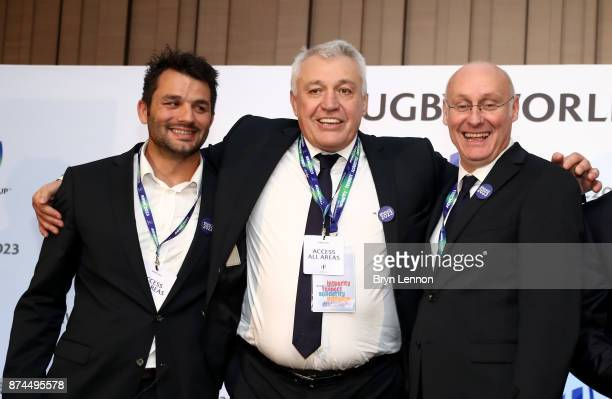 Bernard Laporte of the French bid team and Claude Atcher the France 2023 bid chairman celebrate after being annouced as the host nation for the 2023...