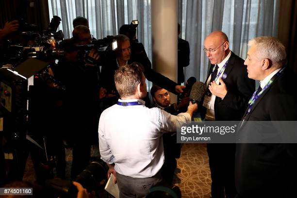 Bernard Laporte of the French bid team speaks to media while Claude Atcher the France 2023 bid chairman looks on during the Rugby World Cup 2023 Host...