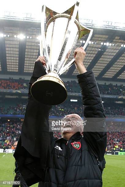 Bernard Laporte the head coach of Toulon celebrates with the trophy following his team's victory during the European Rugby Champions Cup Final match...