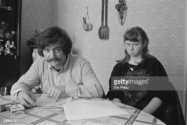 Bernard Laroche, seated next to his sister-in-law, Murielle Bolle, reviews the court transcription of Bolle's verbal testimony. Bernard Laroche is...