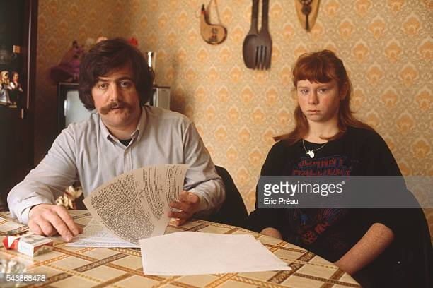 Bernard Laroche seated next to his sisterinlaw Murielle Bolle reviews the court transcription of Bolle's verbal testimony Bernard Laroche is the...