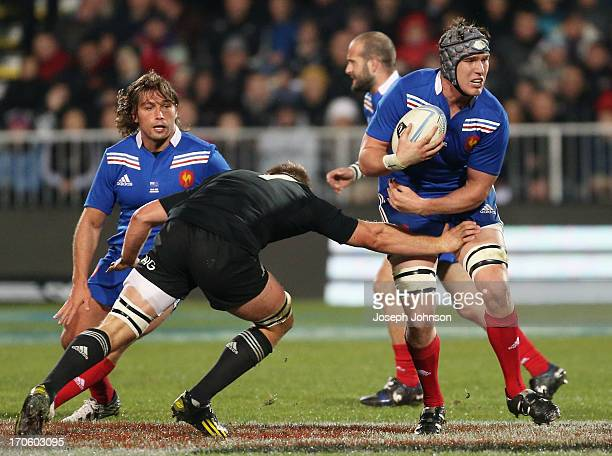 Bernard Le Roux of France in the tackle is Sam Cane of the All Blacks during the International Test match between the New Zealand All Blacks and...