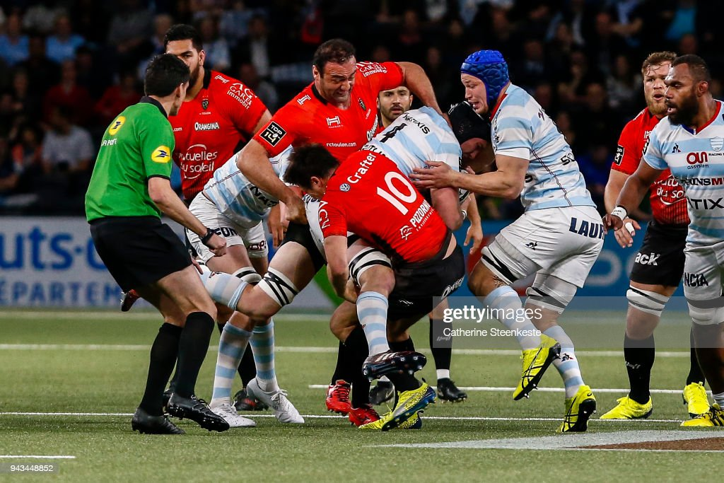 Bernard Le Roux #4 of Racing 92 is tackled by Mamuka Gorgodze #7 of RC Toulon and Francois Trinh-Duc #10 of RC Toulon during the French Top 14 match between Racing 92 and RC Toulon at U Arena on April 8, 2018 in Nanterre, France.