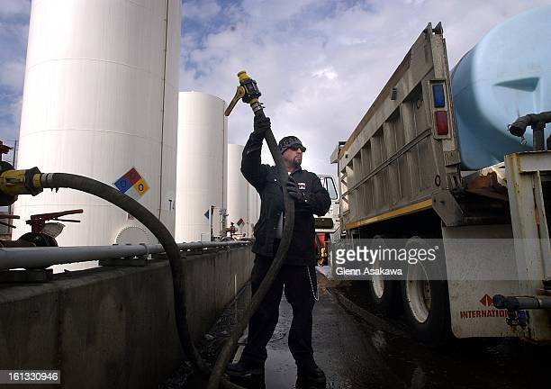 Bernard Loya attaches a hose to his truck to load up 950 gallons of magnesium chloride deicer at the City of Denver Street facility at 3501 Park Ave...