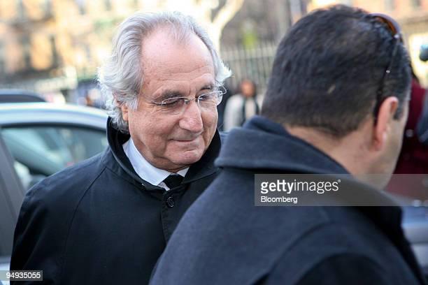 Bernard Madoff founder of Bernard L Madoff Investment Securities LLC left arrives outside federal court in New York US on Wednesday Jan 14 2009...