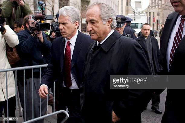 Bernard Madoff founder of Bernard L Madoff Investment Securities LLC center is escorted into Federal court in New York US on Tuesday March 10 2009...