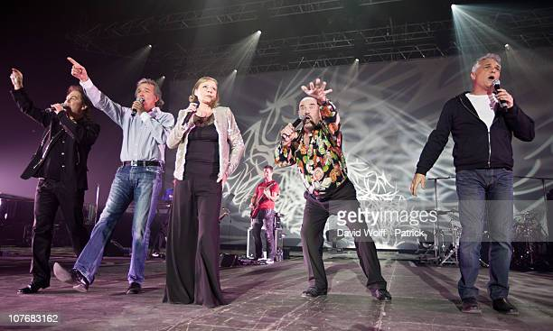 Bernard Minet, Claude Framboisier, Eric Bouad and Remy Sarrazin of Les Muscles perform live with Dorothee at Palais Omnisports de Bercy on December...