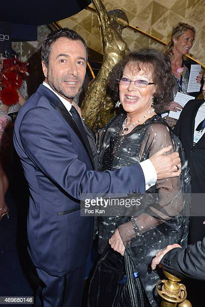 Bernard Montiel and Claudia Cardinale attend the 'Globes De Cristal' 2015 Award Ceremony At The Lido on April 13 2015 in Paris France