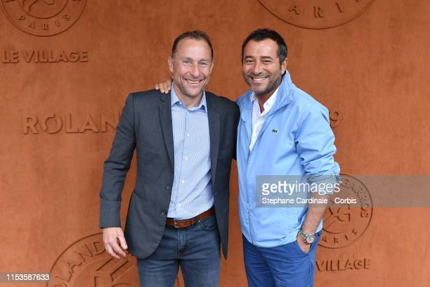 Bernard Montiel and Jean Pierre Papin attend the 2019 French Tennis Open - Day Eight at Roland Garros on June 03, 2019 in Paris, France.