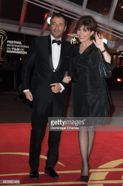 Bernard Montiel and Liane Foly arrive at the opening ceremony of the 13th Marrakesh International Film Festival on November 29 2013 in Marrakech...