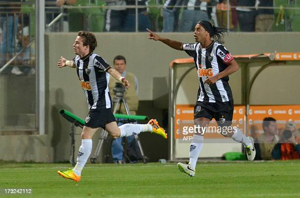 Bernard of Atletico Mineiro celebrates after scoring against Newell's Old Boys of Argentina during their Libertadores Cup semifinal match at Arena...