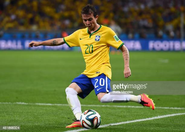 Bernard of Brazil strikes the ball during the 2014 FIFA World Cup Brazil Semi Final match between Brazil and Germany at Estadio Mineirao on July 8...