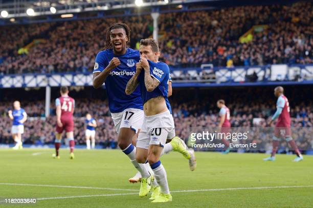 Bernard of Everton celebrates his goal with Alex Iwobi during the Premier League match between Everton and West Ham United at Goodison Park on...