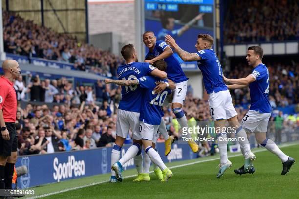 Bernard of Everton celebrates his goal with Gylfi Sigurdsson Richarlison Lucas Digne and Seamus Coleman during the Premier League match between...