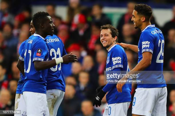 Bernard of Everton is congratulated by his teammates after scoring his side's second goal during the FA Cup Third Round match between Everton and...