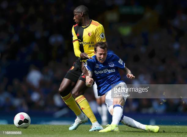 Bernard of Everton is tackled by Adrian Mariappa of Watford during the Premier League match between Everton FC and Watford FC at Goodison Park on...
