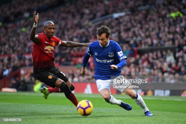 Bernard of Everton runs past Ashley Young of Manchester United during the Premier League match between Manchester United and Everton FC at Old...