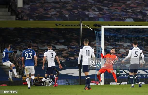 Bernard of Everton scores his team's fifth goal past Hugo Lloris of Tottenham Hotspur during The Emirates FA Cup Fifth Round match between Everton...