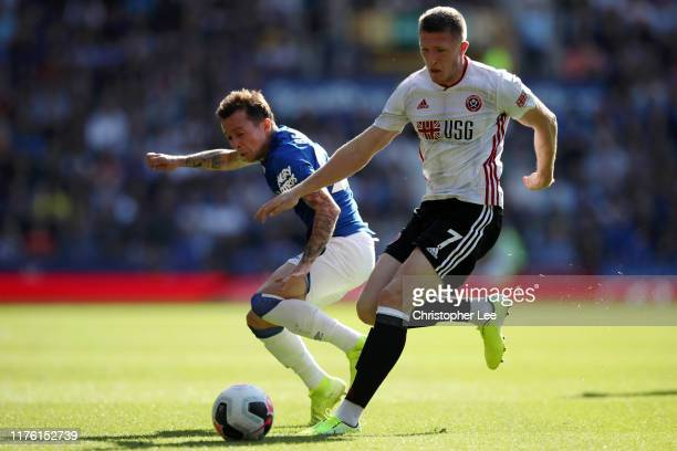 Bernard of Everton takes on John Lundstram of Sheffield United during the Premier League match between Everton FC and Sheffield United at Goodison...