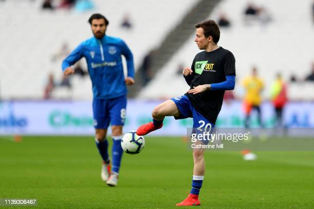 Bernard of Everton warms up while wearing the Kick it out tshirt prior to the Premier League match between West Ham United and Everton FC at London...